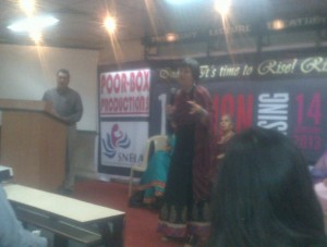 Eve Ensler addresses the audience at the event organized by Sneha, a local NGO and Poorbox Productions. Kaizad Kotwal of Poorbox looks on.